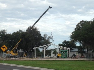 The framework for the playground shade goes into place.
