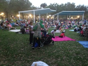 "The crowd gathers to watch ""Dinosaur"" in Sims Park."